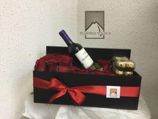 Caja larga chocolates y botella